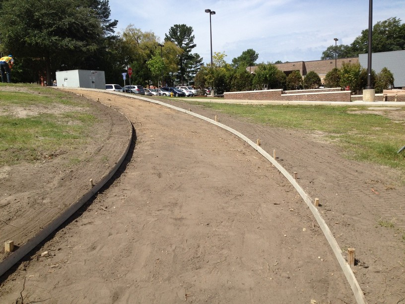 New Sidewalk And Flower Beds Installed At Fayetteville